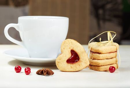 valentine day cup of coffee: Heart shaped cookies and cup of tea