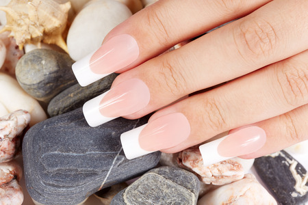 acrylic nails: Nails with long artificial french manicure Stock Photo