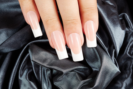 artificial nails: Nails with long artificial french manicure Stock Photo