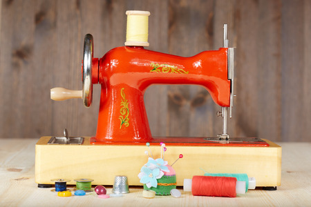 Vintage manual sewing machine and accessories for sewing