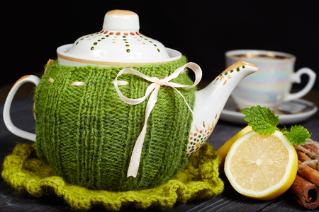 spokes: Teapot with handmade knitted cover, lemon, cinnamon, mint