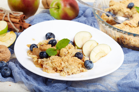 Delicious crumble pie with apples and cinnamon. Sweet dessert.