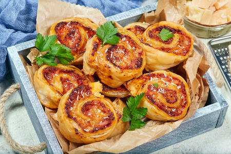 Delicious homemade puff pastry Pizza rolls with ham and cheese