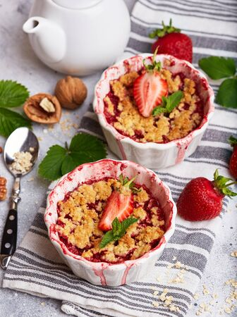 Crumble pie with strawberries. Delicious portion sweet dessert with oat and nuts