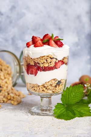 Healthy dessert with granola, yogurt and strawberrie
