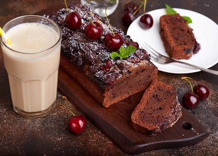 Chocolate brownie cake with cherries. Delicious homemade sweet dessert.