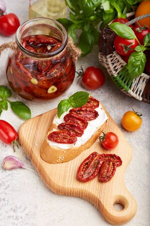 Bruschetta with goat cheese, sun dried tomatoes and basil leaf. Vegetarian food Banco de Imagens