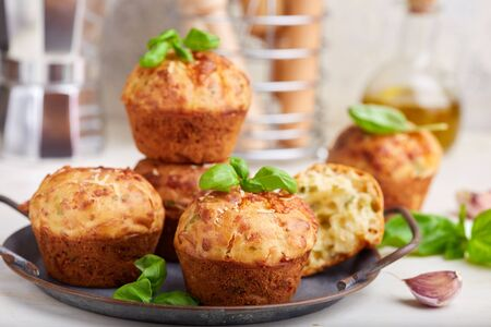 Muffins with parmesan and mozzarella cheese, garlic and herbs. Savory taste