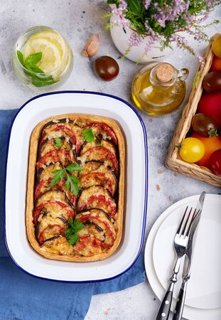 Quiche open tart pie with tomatoes, eggplant and cheese. Vegetarian dish. Savory taste