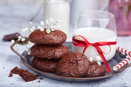 Chocolate brownie cookies served with glass of milk 写真素材