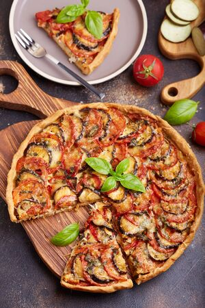 Quiche open tart pie with chicken meat tomatoes, eggplant and cheese. Savory taste