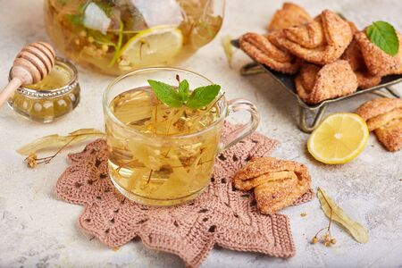 Hot herbal tea with linden flowers, lemon, honey and mint. Delicious autumn and winter beverage
