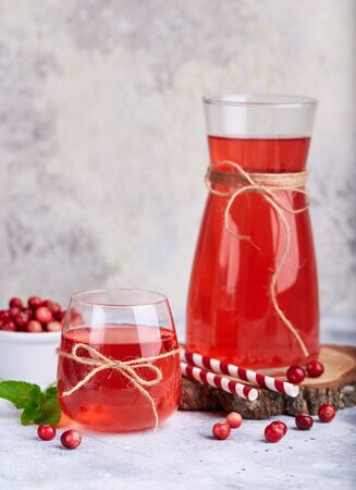 Healthy cranberry juice drink and fresh cranberries. Traditional Russian beverage mors.