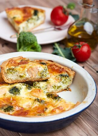 Quiche open tart pie with salmon fish, broccoli and cheese. Savory taste