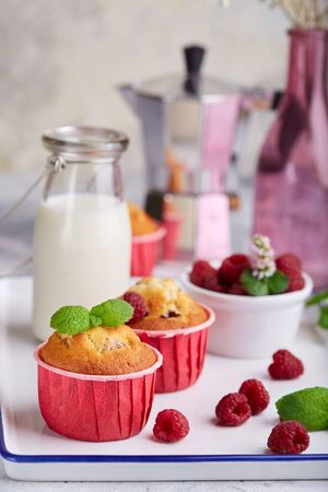 Muffins with raspberries. Delicious homemade sweet dessert. Coffee break
