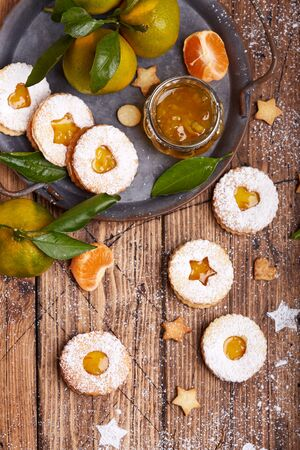Linzer Christmas cookies with tangerine jam and sugar powder. Delicious biscuits. Sweet dessert.
