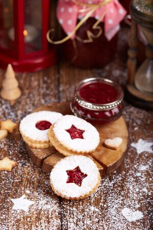 Linzer Christmas cookies with raspberry jam and sugar powder. Delicious biscuits. Sweet dessert.