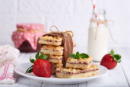 Pie bars with strawberry jam. Delicious homemade sweet dessert from shortcrust pastry. Stock Photo