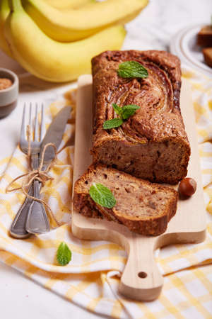 Banana bread with walnuts, hazelnuts and cinnamon. Sweet homemade dessert.