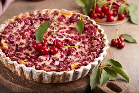 Clafoutis traditional French sweet pie with cherries. Delicious summer homemade cake.
