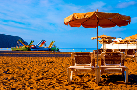Beach chair with umbrella with blue sky on beautiful tropical beach,Relaxing time. Tenerife