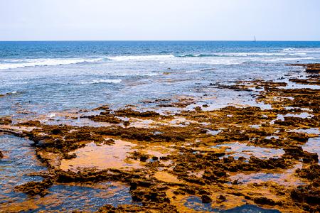 View of the Atlantic coast in Tenerife. Beach, volcanic stones, pebbles. Tenerife
