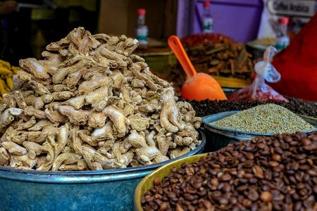 Traditional Spices at the market Marrakesh, Morocco. Coffee, paprika, ginger, dried ginger, pepper, corn, nuts, turmeric.