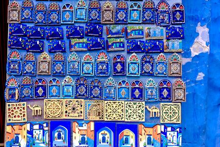 Souvenirs and gifts on the streets of Chefchaouen. Beautiful magnets on the streets of Morocco. Morocco, Chefchaouen April 24, 2019