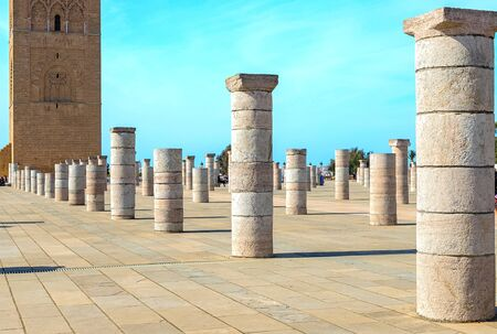 View of the square with ruins and the Hassan tower against the blue sky. Rabat, Morocco 写真素材
