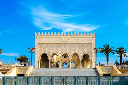 View of the snow-white Mausoleum of Mohammed V against the blue sky. Rabat, Morocco 写真素材