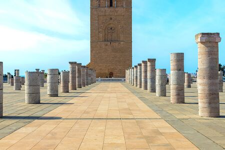 View of the square with ruins and the Hassan tower against the blue sky. Traditional Arabian architecture Rabat, Morocco 22.04.2019 写真素材