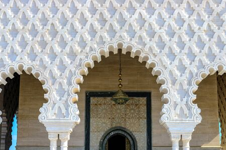 View of part of the facade of the Mausoleum of Mohammed V against the blue sky. Rabat, Morocco 22,04,2019