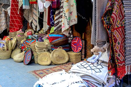 Moroccan carpets with vibrant colors for sale in the narrow street of Rabat in Morocco with selective focus. Morocco