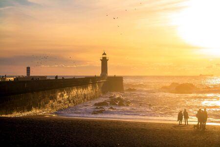 Felgueiras Lighthouse on shore of Atlantic ocean in Porto, Portugal at sunset. Standard-Bild
