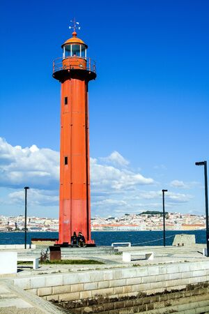 Bright day landscape. Red lighthouse against the sky. Lisbon, Portugal 写真素材