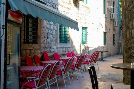 Street cafe on a narrow street in the old town of Kotor, Montenegro, August 2018 Stock Photo