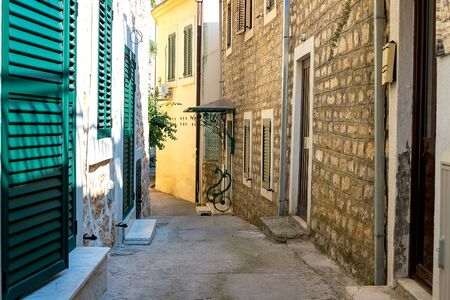 Winding street of the authentic, old town of Herceg Novi, Montenegro. We see old houses and very narrow.