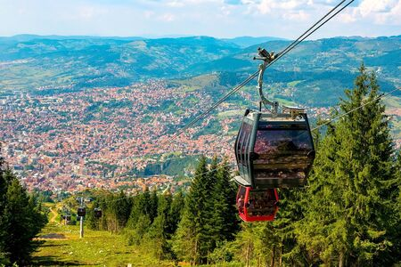 View from the top of the mountain on the city of Sarajevo and funiculars rising up to the highest point of the city. Sarajevo, Bosnia and Herzegovina