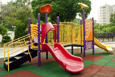 playground equipment: Colorful playground in a park. Stock Photo