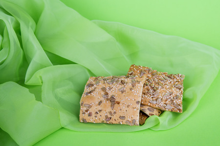 cookies on green cloth. Dietary biscuits with seeds. Puff pastry on a green background