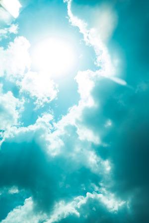 corona sun in nice blue sky clouds gap Stock Photo