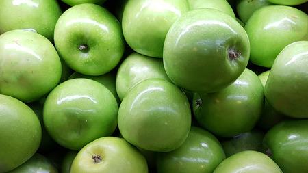 Fresh green apples background. Green apples texture. Fruit in Supermarket.