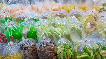 Various kind of Thai packed fruits ready to serve.