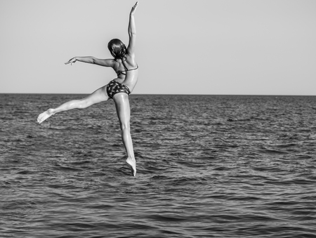 nice jump in the summer sea photo