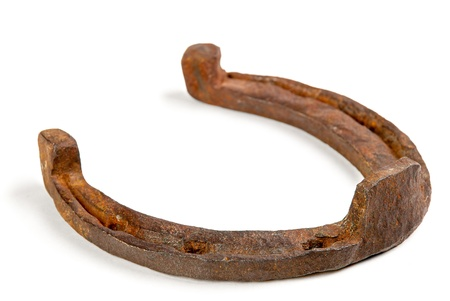 One old rusty horseshoe on a white background photo