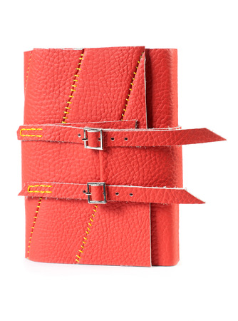buckles: Red Leather Closed Paper Notepad With Buckles Isolated On White Background