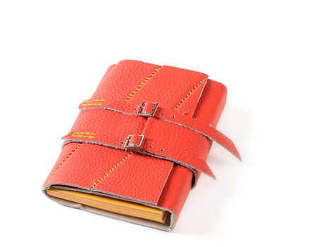 buckles: Red Leather Closed Notepad With Buckles Isolated On White Background