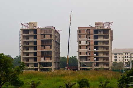 The two buildings are under construction, and sustainable development.