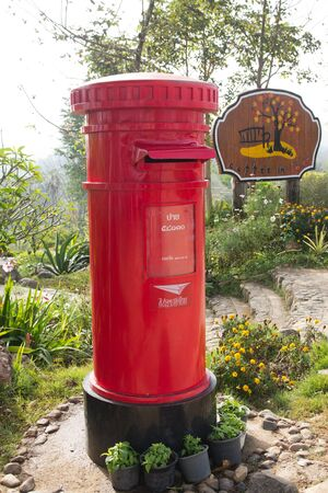 Red Post Box, a garden background.