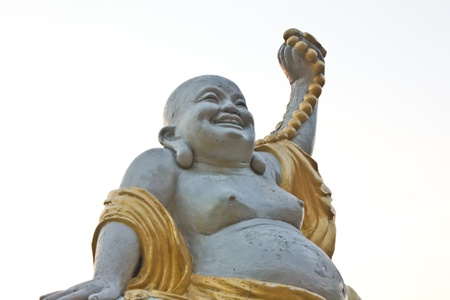 Statues of Buddha a happy laughing buddha s face in China